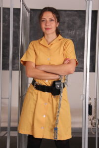 Anahi from CuffGirl.com is one of the guards you can book for your Bondage Timeout!